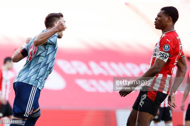 Dusan Tadic of Ajax celebrates 1-1, Denzel Dumfries of PSV during the Dutch Eredivisie match between PSV v Ajax at the Philips Stadium on February...