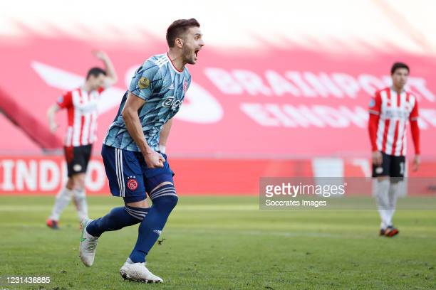 Dusan Tadic of Ajax celebrates 1-1 during the Dutch Eredivisie match between PSV v Ajax at the Philips Stadium on February 28, 2021 in Eindhoven...