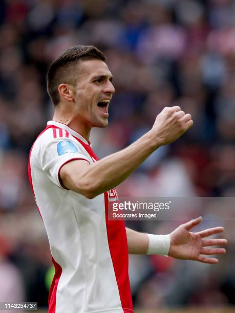 Dusan Tadic of Ajax celebrates 31 during the Dutch Eredivisie match between Ajax v FC Utrecht at the Johan Cruijff Arena on May 12 2019 in Amsterdam...