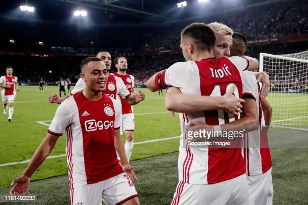 Dusan Tadic of Ajax celebrates 31 with Donny van de Beek of Ajax Hakim Ziyech of Ajax Sergino Dest of Ajax during the UEFA Champions League match...