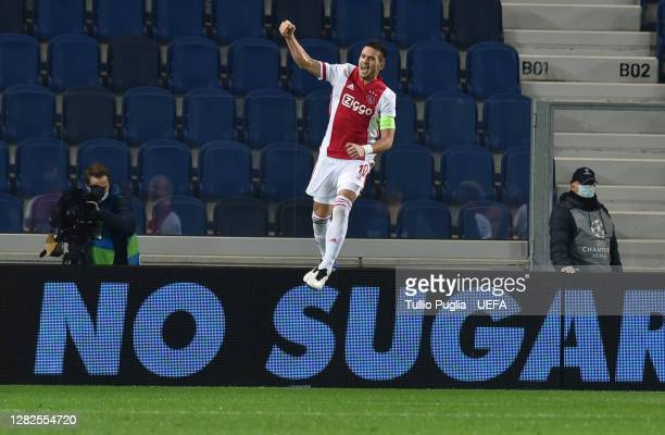 Dusan Tadic of Ajax celebrates after scoring his sides first goal from the penalty spot during the UEFA Champions League Group D stage match between...
