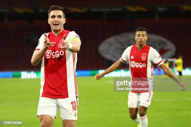 Dusan Tadic of Ajax celebrates after scoring their team's second goal during the UEFA Europa League Round of 16 First Leg match between Ajax and BSC...
