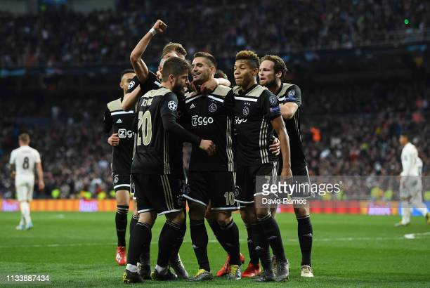 Dusan Tadic of Ajax celebrates as he scores his team's third goal with team mates during the UEFA Champions League Round of 16 Second Leg match...