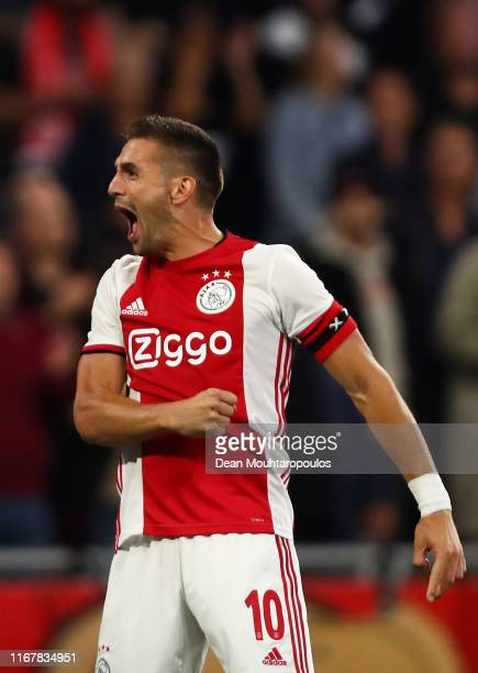 Dusan Tadic of Ajax celebrates scoring his sides third goal during the UEFA Champions League Third Qualifying Round match between Ajax and PAOK...