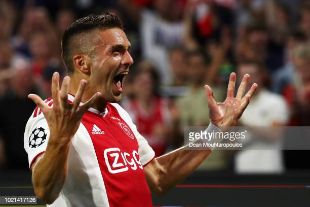 Dusan Tadic of Ajax celebrates scoring his teams third goal of the game during the UEFA Champions League Playoff 1st leg match between Ajax and...