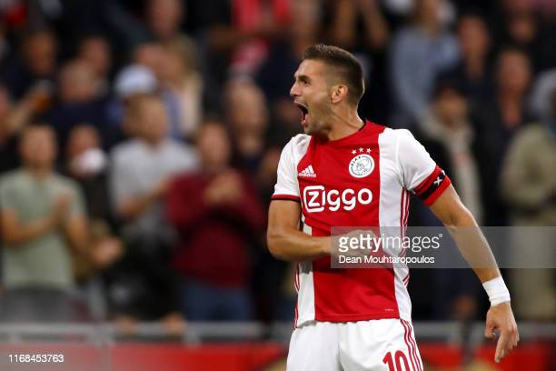 Dusan Tadic of Ajax celebrates scoring his teams third goal of the game during the UEFA Champions League 3rd Qualifying match between Ajax and PAOK...