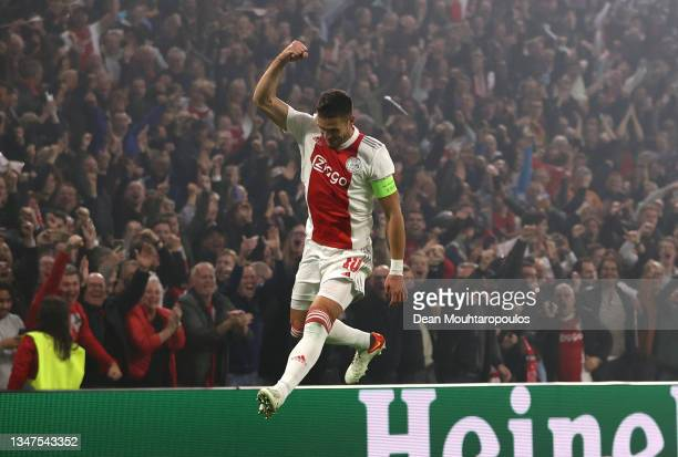 Dusan Tadic of Ajax celebrates their side's first goal, an own goal by Marco Reus of Borussia Dortmund during the UEFA Champions League group C match...