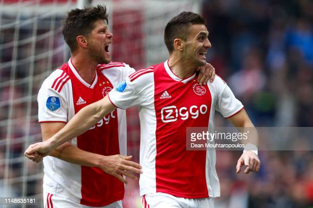Dusan Tadic of Ajax celebrates with his team mate Klaas Jan Huntelaar after scoring his team's fourth goal from the penalty spot during the...