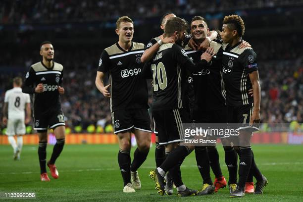 Dusan Tadic of Ajax celebrates with his team mates after scoring his team's third goal during the UEFA Champions League Round of 16 Second Leg match...