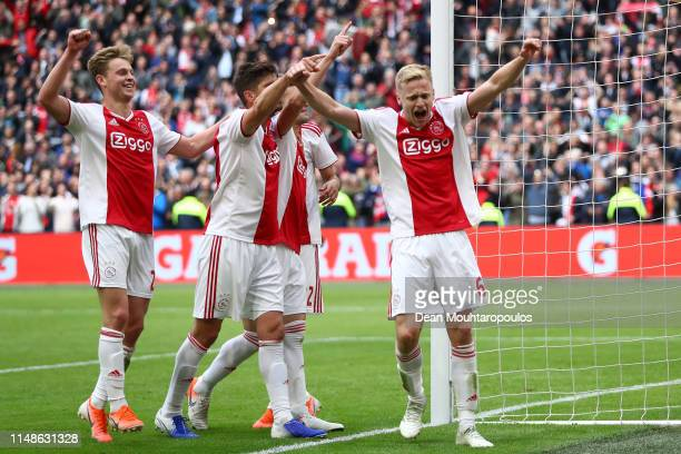 Dusan Tadic of Ajax celebrates with his team mates after scoring his team's fourth goal from the penalty spot during the Eredivisie match between...