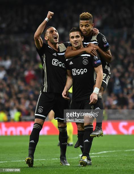 Dusan Tadic of Ajax celebrates with his team mates Hakim Ziyech and David Neres after scoring his team's third goal during the UEFA Champions League...