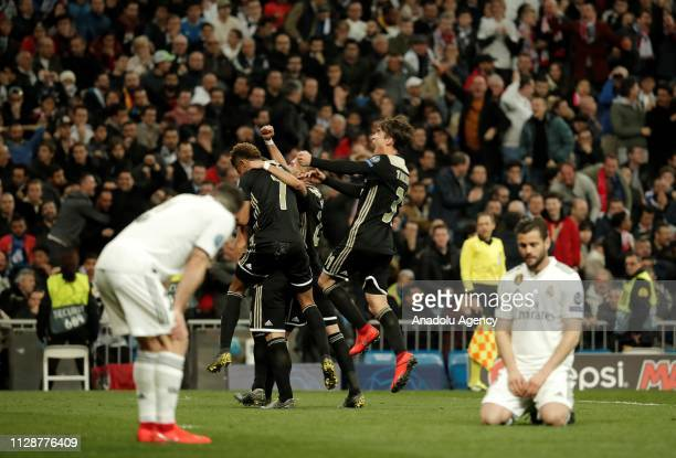 Dusan Tadic of Ajax celebrates with his teammates after scoring a goal during UEFA Champions League Round of 16 second leg match between Real Madrid...