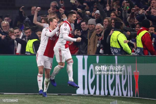 Dusan Tadic of Ajax celebrates with team mates after scoring his sides second goal during the UEFA Champions League Group E match between Ajax and FC...