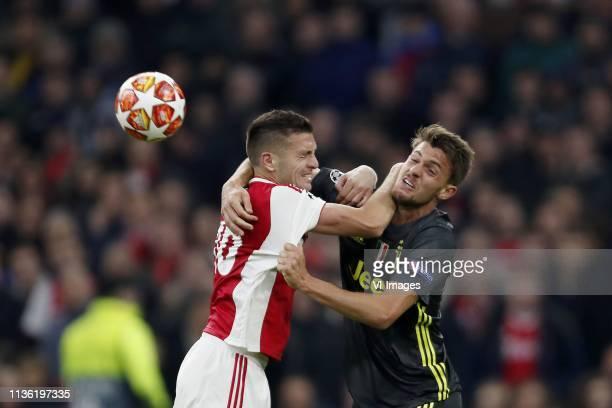 Dusan Tadic of Ajax Daniele Rugani of Juventus FC during the UEFA Champions League quarter final match Ajax Amsterdam and Juventus FC at the Johan...