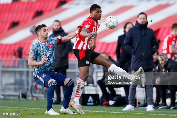 Dusan Tadic of Ajax, Denzel Dumfries of PSV during the Dutch Eredivisie match between PSV v Ajax at the Philips Stadium on February 28, 2021 in...