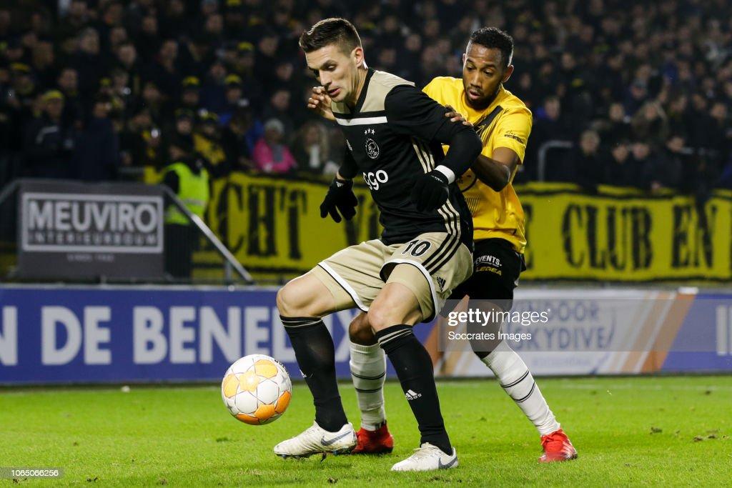 Dusan Tadic Of Ajax, Fabian Sporkslede Of NAC Breda During
