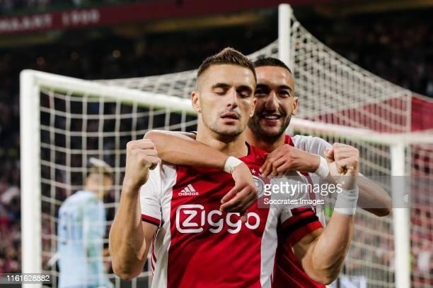 Dusan Tadic of Ajax, Hakim Ziyech of Ajax during the UEFA Champions League match between Ajax v PAOK Saloniki at the Johan Cruijff Arena on August...
