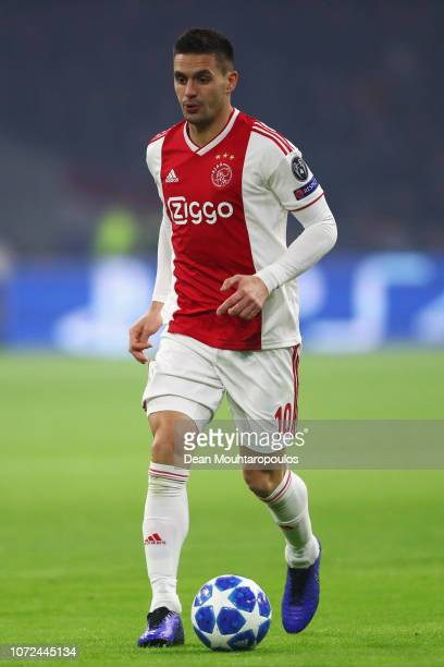 Dusan Tadic of Ajax in action during the UEFA Champions League Group E match between Ajax and FC Bayern Munich at Johan Cruyff Arena on December 12...
