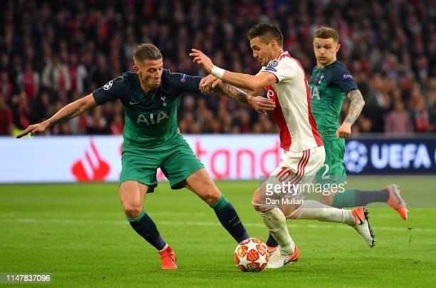 Dusan Tadic of Ajax is challenged by Jan Vertonghen of Tottenham Hotspur during the UEFA Champions League Semi Final second leg match between Ajax...
