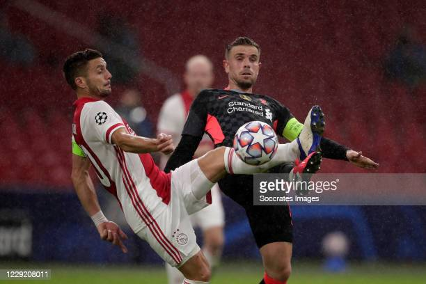 Dusan Tadic of Ajax Jordan Henderson of Liverpool during the UEFA Champions League match between Ajax v Liverpool at the Johan Cruijff Arena on...