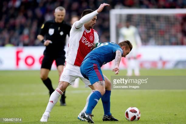 Dusan Tadic of Ajax Jordy Clasie of Feyenoord during the Dutch Eredivisie match between Ajax v Feyenoord at the Johan Cruijff Arena on October 28...