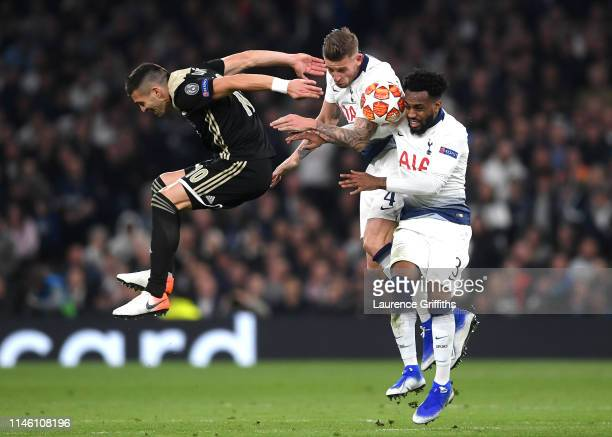 Dusan Tadic of Ajax jumps with Toby Alderweireld and Danny Rose of Tottenham Hotspur during the UEFA Champions League Semi Final first leg match...