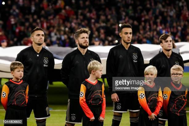 Dusan Tadic of Ajax Lasse Schone of Ajax Noussair Mazraoui of Ajax Nicolas Tagliafico of Ajax during the UEFA Champions League match between Bayern...