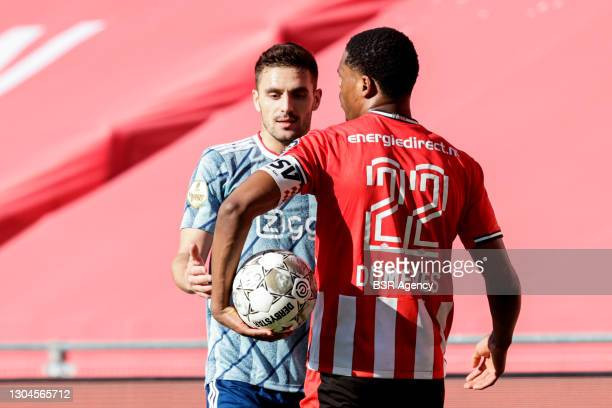 Dusan Tadic of Ajax of Denzel Dumfries of PSV during the Dutch Eredivisie match between PSV and Ajax at Philips Stadion on February 28, 2021 in...