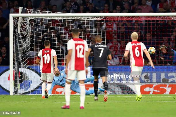 Dusan Tadic of Ajax scores his sides first goal from the penalty spot past Alexandros Paschalakis of PAOK during the UEFA Champions League Third...
