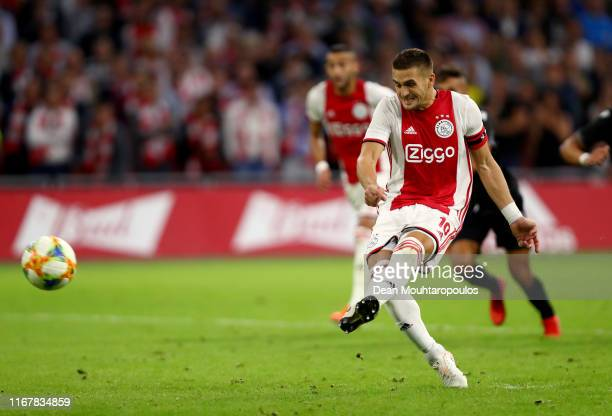 Dusan Tadic of Ajax scores his sides third goal during the UEFA Champions League Third Qualifying Round match between Ajax and PAOK Saloniki at Johan...
