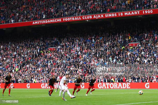 Dusan Tadic of Ajax scores his team's fourth goal from the penalty spot during the Eredivisie match between Ajax and Utrecht at Johan Cruyff Arena on...