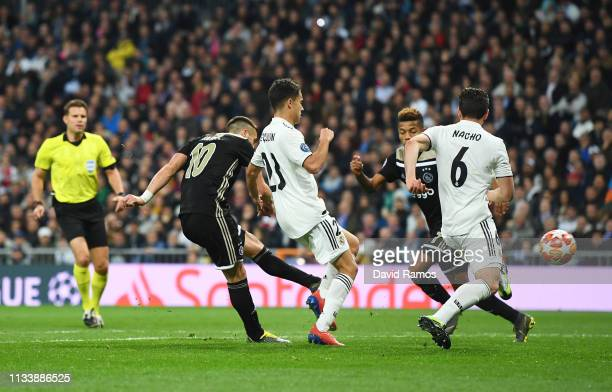 Dusan Tadic of Ajax scores his team's third goal during the UEFA Champions League Round of 16 Second Leg match between Real Madrid and Ajax at...