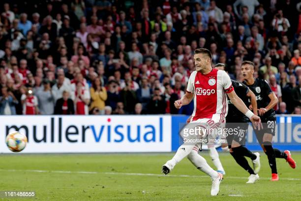 Dusan Tadic of Ajax scores the second goal to make it 1-1 during the UEFA Champions League match between Ajax v PAOK Saloniki at the Johan Cruijff...