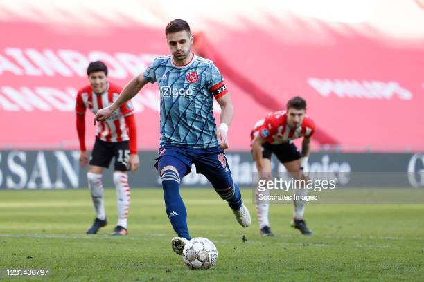Dusan Tadic of Ajax scores the second goal to make it 1-1 during the Dutch Eredivisie match between PSV v Ajax at the Philips Stadium on February 28,...