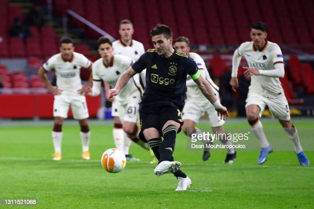 Dusan Tadic of Ajax takes a penalty and misses during the UEFA Europa League Quarter Final First Leg match between Ajax and AS Roma at Johan Cruijff...