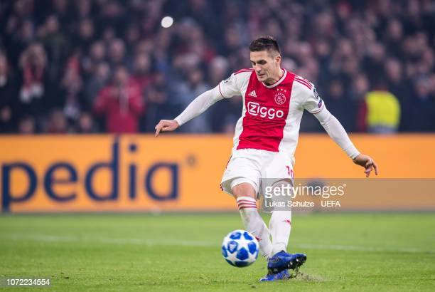 Dusan Tadic of Amsterdam scores the penalty and the second goal of his team during the UEFA Champions League Group E match between Ajax Amsterdam and...