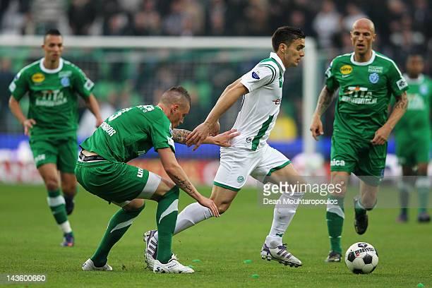 Dusan Tadic of Groningen and Vito Wormgoor of De Graafschap battle for the ball during the Eredivisie match between FC Groningen and De Graafschap at...