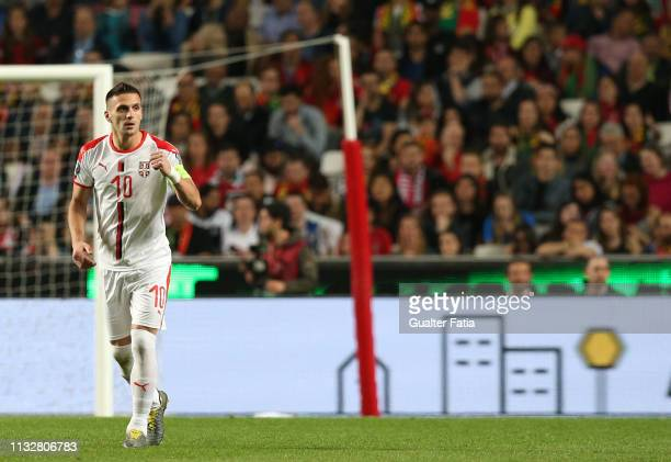 Dusan Tadic of Serbia celebrates after scoring a goal during the UEFA EURO 2020 Qualifier match between Portugal and Serbia at Estadio da Luz on...