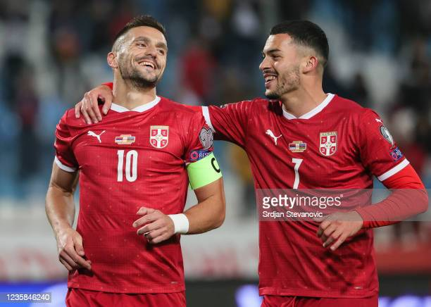 Dusan Tadic of Serbia celebrates after scoring a goal with Nemanja Radonjic during the 2022 FIFA World Cup Qualifier match between Serbia and...