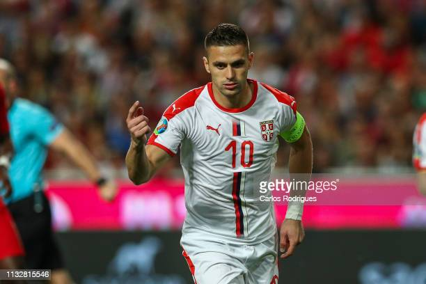 Dusan Tadic of Serbia celebrates scoring Serbia goal during the 2020 UEFA European Championships qualifying match between Portugal and Ukraine at...