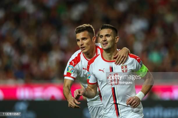 Dusan Tadic of Serbia celebrates scoring Serbia goal with Darko Lazovic of Serbia during the 2020 UEFA European Championships qualifying match...