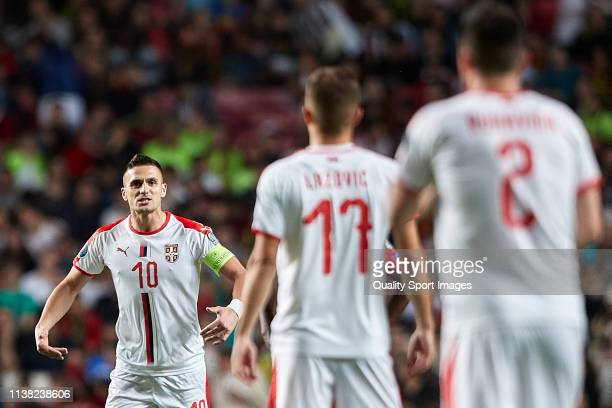 Dusan Tadic of Serbia celebrates with his team mates after scoring his team's first goal during the 2020 UEFA European Championships group B...
