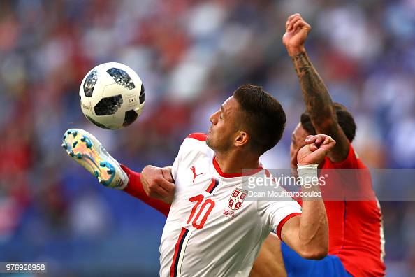 Dusan Tadic Of Serbia Controls The Ball Under Pressure