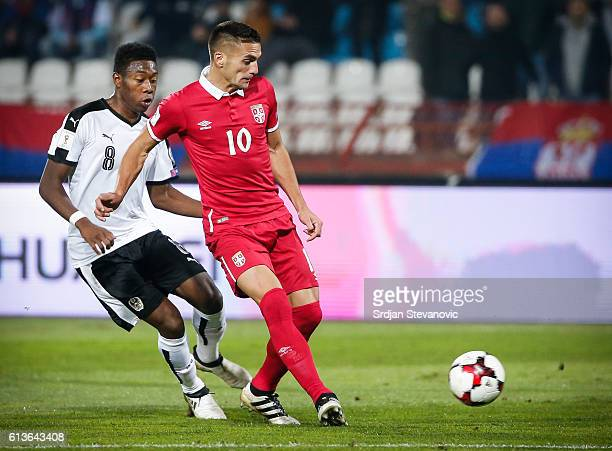 Dusan Tadic of Serbia in action against David Alaba of Austria during the FIFA 2018 World Cup Qualifier between Serbia and Austria at stadium Rajko...