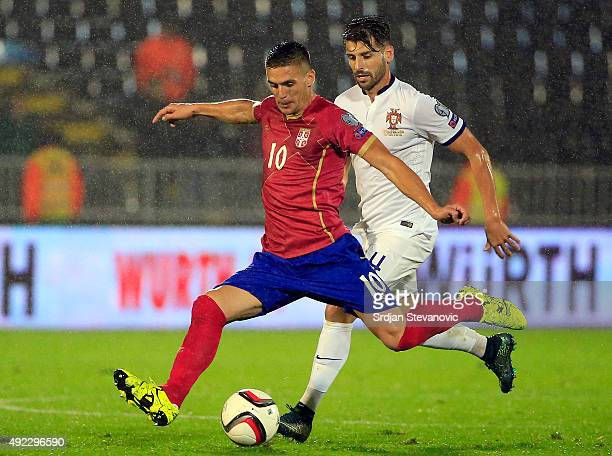 Dusan Tadic of Serbia in action against Miguel Veloso of Portugal during the Euro 2016 qualifying football match between Serbia and Portugal at the...