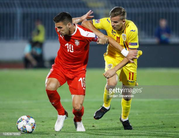 Dusan Tadic of Serbia in action against Nicusor Bancu of Romania during the UEFA Nations League C group four match between Serbia and Romania at...