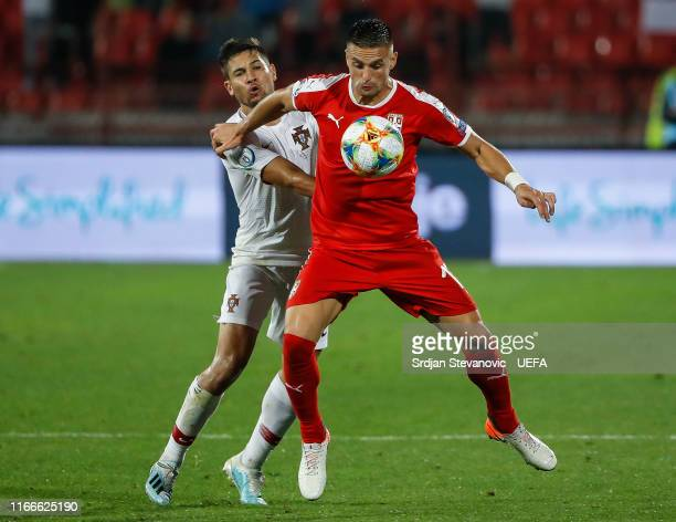 Dusan Tadic of Serbia in action against Raphael Guerreiro of Portugal during the UEFA Euro 2020 qualifier between Serbia and Portugal at Stadium...