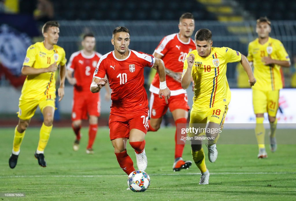 Dusan Tadic Of Serbia In Action Against Razvan Marin Of