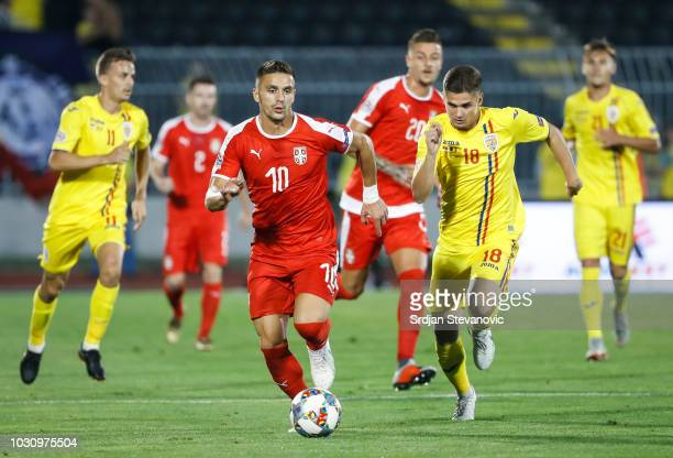 Dusan Tadic of Serbia in action against Razvan Marin of Romania during the UEFA Nations League C group four match between Serbia and Romania at...