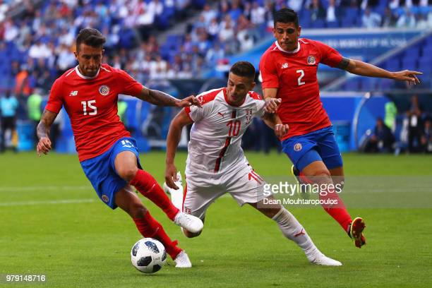 Dusan Tadic of Serbia is challenged by Francisco Calvo of Costa Rica and Johnny Acosta of Costa Rica during the 2018 FIFA World Cup Russia group E...